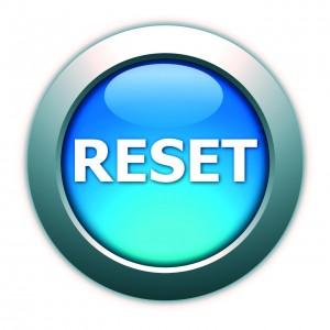 Immagine di un pulsante azzurro con sopra la scritta RESET